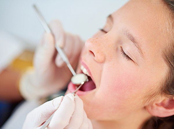 Relaxed child receiving dental treatment