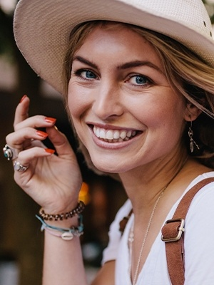 Woman in sunhat smiling
