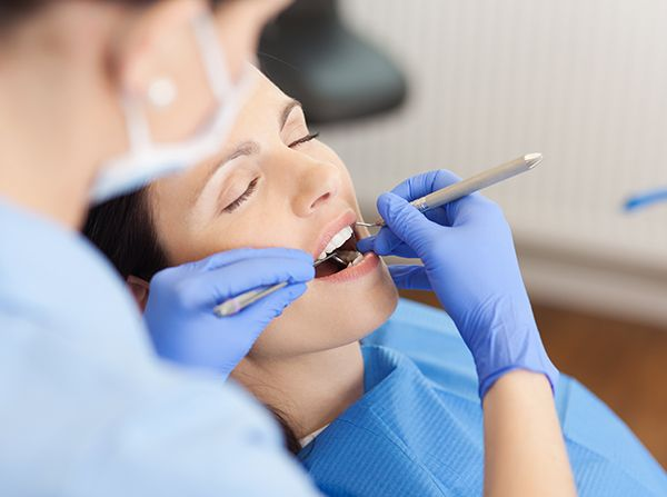 Relaxed patient receiving dental treatment