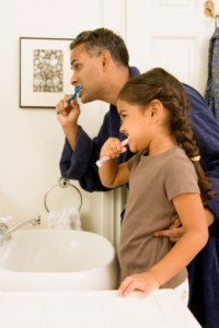father and daughter practice great at-home oral hygiene thanks to the family dentist Leesburg loves